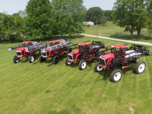 all four Apache Sprayers models lined up in a field